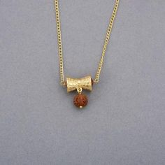 Rudraksha pendant online just got ten times more Vogue-worthy. It is a high-end fashion trend people may have forgotten. Bring it back with this traditional pendant for men. Mens Gold Jewelry, Raw Gemstone Jewelry, Gold Jewelry Simple, Stylish Jewelry, Jewelry Design Earrings, Pendant Jewelry, Pendant Necklace, Jewellery, Gold Pendants For Men