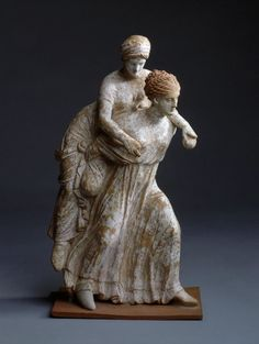 Girls Playing (Ephedrismos). Place: Ancient Greece. Date: Early 3rd century BC. Material: clay. Dimension: h. 26 cm.  | © 1998 - 2015 The State Hermitage Museum.