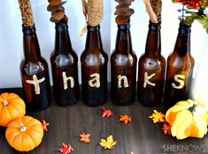 Beer bottle decor. Paint letters on empty bottles and use as vases for sprigs of fall (or any season) decor. Love it!