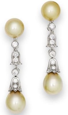 A pair of cultured pearl and diamond pendent earrings, by Cartier  Each cultured pearl surmount of golden tint, suspending an articulated row of brilliant-cut diamonds with diamond-set floral connecting link, terminating in a drop-shaped cultured pearl of similar tint with brilliant-cut diamond floral cap, diamonds approximately 2.10 carats total, signed Cartier and numbered, French assay marks, length 5.5cm.