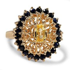 The Floria Ring from Brilliant Earth - This breathtaking modern estate ring features an oval yellow sapphire surrounded by a yellow gold scroll design and a halo of twenty two round sapphire accents, for chic and dramatic effect. Editorial note - I don't normally like yellow gold (though this looks a bit more like rose gold...) or yellow much in general but this is oddly lovely.