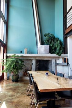 The dining room in this home in Seattle's Fremont neighborhood looks out on a firepit and hot tub. The house has 25-foot windows and views of Mount Rainier.