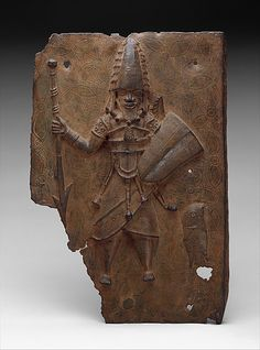 Plaque: Warrior  Date:     16th–17th century Geography:     Nigeria, Court of…