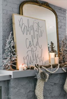 Tinsel trees and stockings are super traditional, and always make guests feel like holiday has arrived. Take it up a notch with a sign that displays a line from a favorite festive tune. See the full home tour at Kindred Vintage & Co. »
