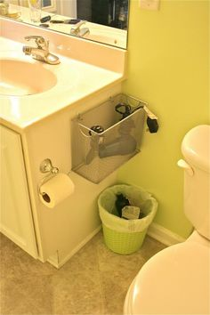 such a good idea, basket to keep your hairdryer/straightener/curler off the sink…