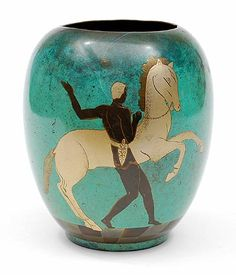 Brass Art Deco Ikora vase with green patinated surface and black and gold colored decoration of man with horse executed by WMF / Germany ca.1935
