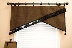 Custom Window Treatments & Bedrooms - Cheryl Hucks Interior Designs Aseymetrical valance with black tassel fringe, gimp