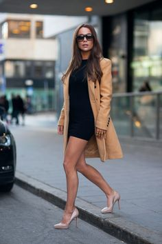 justthedesign:  Johanna Olsson is wearing nude shoes from Christian Loboutin, black dress from Asos Petit, camel coat from Selected Femme and the sunglasses are from Yves Saint Laurent