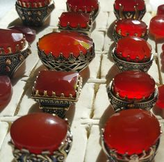 sikver rings with yemeni agate stone.red color.cutting style on stone are angels and dome shapes of diff sizes