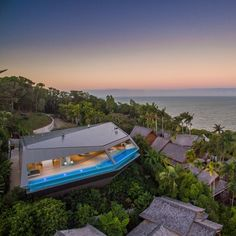THE EDGE is aptly named this fabulous home is very edgy. Set high up and floating among the trees with the best view Port Douglas