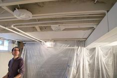 Blog gives a little bit of insight into how they did their basement.  Including painting the ceiling