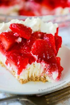 Easy Strawberry Cheesecake Pie is one of our favorite no bake summer desserts! Rich and creamy cheesecake is piled high with glazed summer strawberries and a hint of lemon. This pie is easy to make... and even easier to eat!