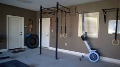 Wall mounted rack, Concept2 rower, tire, and weights somewhere, right? Nice CrossFit set up