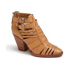 On SALE at 61% OFF! helsa bootie by Dolce Vita. A woven leather bootie with a sculpted stacked heel is finished with silvertone buckles for a chic casual look.