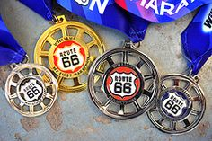 "2010 Williams Route 66 Marathon Finisher Medals - this Half was my first and there's no way I want to do the full in Tulsa since the half was so hilly, but I want to do the quarter marathon just because I don't know of any other ""quarter marathon"" close by! :)"