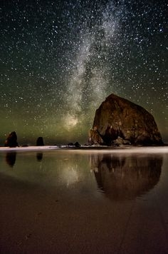 Cannon Beach, Oregon. There's haystack rock! I've seen it in person, but not on a clear night with the stars out. This is amazing, to say the least.