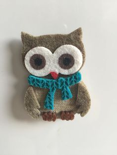 Felt owl fridge magnet (one supplied)  Cute little multi layered felt owl with magnet disc attached to the back.  Each figure is between 6 and 7 cms tall  Other magnets are available in different designs.  All items come in an organza gift bag.