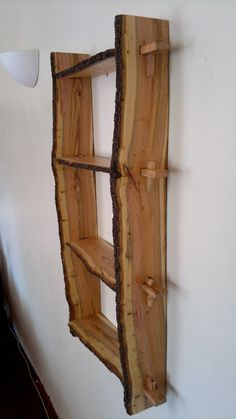 Plum wood shelves. Natural edge, wall-mounted, handmade from bookmatched planks.