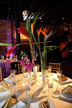 Gold table with an exotic flower centerpiece at Nova 535