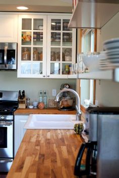 For our kitchen: don't love the main light fixture, but the counter tops, shelves and glass cabinets!! Totally doable!