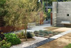 Stone + Gravel + Wood + Silvery Vegetation = Perfect Low-Maintenance Yard  Picture from the-brick-house.com Succulent Landscaping, Modern Landscaping, Outdoor Landscaping, Front Yard Landscaping, Landscaping Ideas, Succulents Garden, Drought Resistant Landscaping, Drought Tolerant Landscape, Porches