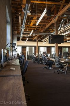 GitHub HQ | MASHstudios | Wood Work Stations http://mashstudios.com/2014/04/30/github-2/  Desk lights and spacing