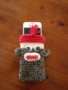 Sock Monkey Cell Phone, iPod Touch Crocheted Case with Red Top and Red Tassel.