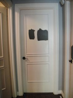 Painting interior doors black. Molding was added.  Love how she did 3 panels of different sizes (she got inspiration from some fancy door place online).  She had a handy man come in and install them.  I can do this using liquid nails and my nail gun.  And the miter saw.