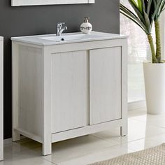 Classic 80cm Single Basin Vanity Unit is the perfect choice for anyone who values simplicity and elegance. The white finish will brighten the interior of each bathroom and add to its character. Shelves offer space to store all necessary items in the bathroom.