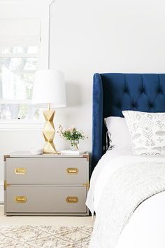 Stunning master bedroom with tufted navy blue velvet wingback headboard and bed frame, paired with patterned gray and white bedding, a gray campaign-style Navy Headboard, Wingback Headboard, Tufted Headboards, Velvet Headboard, Tufted Bed, Velvet Bed Frame, Headboard Ideas, Grey And White Bedding, Decorating Rooms
