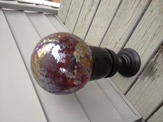 Gazing ball stand - made from a pillar candle holder and small ceramic flower pot.