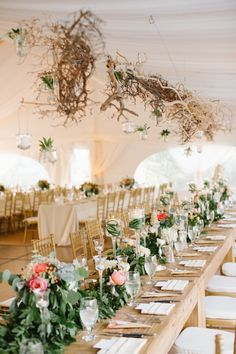 Pretty table setting - green garland, flowers, tall floating candles, votives in champagne glasses, mercury glass votives