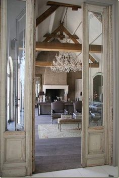 Exposed beams Grand Chandelier. HUGE Fireplace with rock/cobblestone*