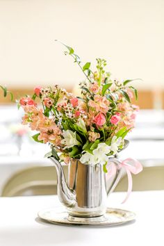 Vintage silverware for a vase! View the full wedding here: http://thedailywedding.com/2016/06/03/antique-hall-wedding-tiffany-torey/