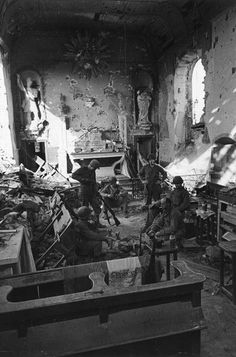 U.S. soldiers are seen in the church of the small Normandy town of St. George D'Elle, July 15, 1944, after they captured the site from German troops, who used the church's steeple strategically as sniper position.