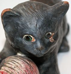 Bretby Art Pottery Lucky Black Cat Glass Eyes With Ball of Wool  Manufacturer:	Bretby Product Type: Animals Sub-Type:	British	Use:	Decorative Material:	Terracotta	 Date: 1940-1959