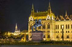 Budapest by night, Parliament Buildings in foreground, Castle Hill in background
