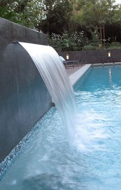 Relaxing Swimming Pool Waterfalls - Swimming pool waterfalls can be added to enhance a swimming pool look. Swimming pool waterfalls cater a natural look, plus the sound of water falling .