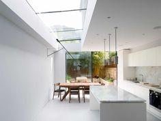 Black steel framed skylights and sliding doors
