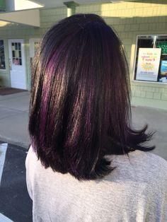 Black hair with purple peekaboos throughout
