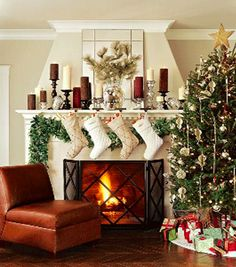 you can hang garland below the mantle to free the top for decorations - this is a great idea!