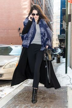 Who: Kendall Jenner  What: A Navy Bandana Scarf Why: With her Citizens of Humanity jeans and a basic Getting Back to Square One grey top, Kendall's look pops thanks to a bold bandana. Get the look now: Saint Laurent scarf, $845, net-a-porter.com   - HarpersBAZAAR.com