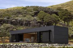 Black Timber Box Offering Mesmerizing Views: Storm Cottage Residence