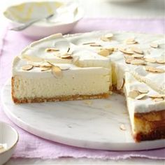 Luscious Almond Cheesecake Recipe -I received this recipe along with a set of springform pans from a cousin at my wedding shower 11 years ago. It makes a heavenly cheesecake. My son Tommy has already told me he wants it again for his birthday cake this year. —Brenda Clifford, Overland Park, Kansas