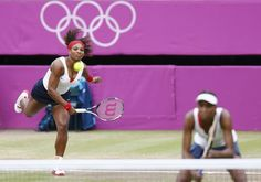 Serena Williams of the U.S. serves over her sister, Venus Williams, to Czech Republic's Hlavackova and Hradecka in the women's doubles tennis gold medal match at the London Olympic Games
