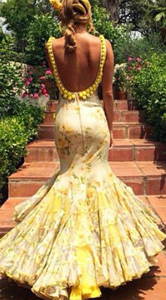 Yellow floral flamenco style dress with low back and pom-poms