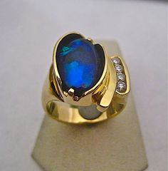 One of a kind extra fine black opal and diamond ring by Glenn Dizon Designs, available for sale. #opalsaustralia