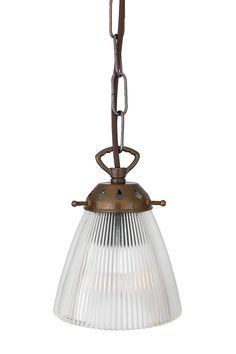 Detailed with a clear prismatic holophane glass, the Gadar Glass Industrial Pendant creates a sparkling glow perfect for industrial interiors.   This holophane pendant light adds visual warmth and illumination above the kitchen island, dining table, workbench or desk.   #pendantlight #supensionlamp #ceilinglight #suspensionfixture #glasslights #glasspendantlight