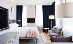 11 Howard in New York.   The takeaway from this hotel's design: Choose sofas and chairs with slim backs and legs to tuck them into the smallest of corners.