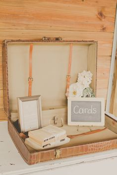 vintage suitcase used to collect cards. One of our favorite ideas!